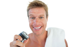 Handsome man holding an electric razor Royalty Free Stock Photography