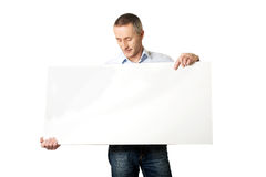 Handsome man holding an empty banner Stock Photo
