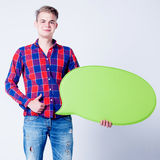 Handsome man holding empty board Stock Photos