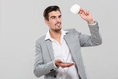 Handsome man holding empty cup Royalty Free Stock Images