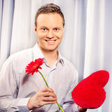 Handsome man holding flower in Valentine day Royalty Free Stock Photography
