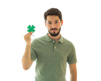 Handsome man holding a four leaf clover. Royalty Free Stock Photos