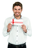 Handsome man holding gift box Stock Photography