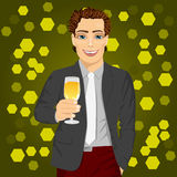 Handsome man holding a glass of champagne at the night club party Royalty Free Stock Image