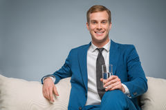 Handsome man holding a glass of water Royalty Free Stock Photo