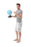 Handsome man holding globe smiling Royalty Free Stock Photo