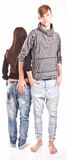 Handsome man holding hand in back pocket of girlfriends jeans Stock Photography