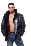 Handsome Man Holding Hands In His Pockets. Portrait of a handsome man in leather jacket holding hands in his pockets over white Royalty Free Stock Photos