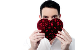 Handsome man holding heart shape gift box Stock Image