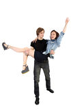 Handsome man holding joyful woman Stock Images