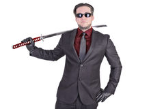 Handsome man holding katana sword Royalty Free Stock Photography