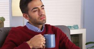 Handsome man holding mug Stock Image