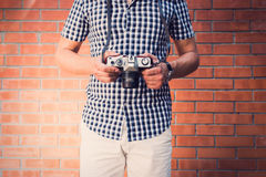Handsome man holding old-fashioned camera Royalty Free Stock Image