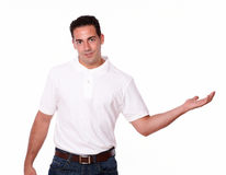 Handsome man holding out his left palm Stock Photo