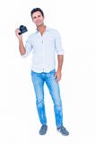 Handsome man holding photo camera Royalty Free Stock Images