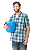 Handsome man holding plastic bucket. Royalty Free Stock Images