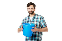 Handsome man holding plastic bucket. Royalty Free Stock Photo