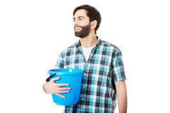 Handsome man holding plastic bucket. Stock Image