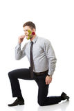 Handsome man holding red rose in his mouth. Stock Photo