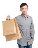 Handsome man holding shopping bag Stock Image