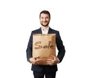Handsome man holding shopping bag Stock Photos