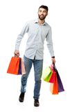 Handsome man holding shopping bags on white background Stock Image