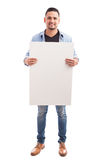 Handsome man holding a sign Royalty Free Stock Image