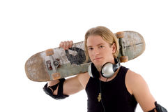 Handsome man holding skateboard. Against white background Royalty Free Stock Images