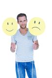 Handsome man holding smiley faces Royalty Free Stock Photography