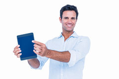 Handsome man holding tablet computer Stock Images