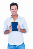 Handsome man holding tablet computer Stock Photo