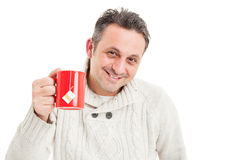 Handsome man holding tea mug and wearing knitted sweater Stock Photo