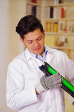 Handsome man holding a toner during maintenance Stock Image