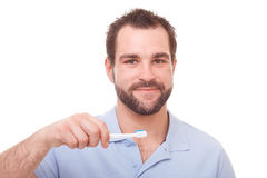 Handsome man holding a toothbrush Stock Image