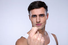 Handsome man holding tweezers Royalty Free Stock Photography