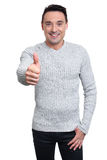 Handsome man holds his thumbs up Stock Photo