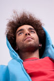 Handsome man with a hood, view from below. Stock Photo