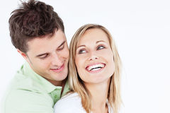 Handsome man hugging his laughing girlfriend Stock Photo