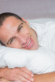 Handsome man hugging his pillow Stock Images