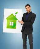 Handsome man illustration of eco house Stock Image