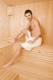 Handsome Man In A Towel Relaxing In Sauna Royalty Free Stock Photography
