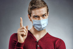 Free Handsome Man In Protective Mask Pointing Finger Up Royalty Free Stock Images - 86306309