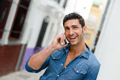 Handsome Man In Urban Background Talking On Phone Royalty Free Stock Image