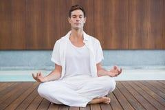Free Handsome Man In White Meditating In Lotus Pose Stock Photo - 42544300