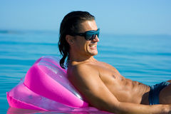 Handsome man on inflatable raft Royalty Free Stock Image