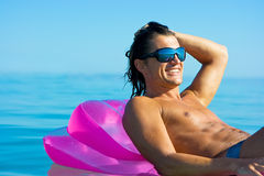 Handsome man on inflatable raft Stock Photography