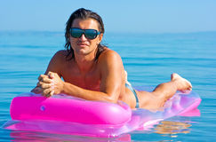 Handsome man on inflatable raft Royalty Free Stock Photo