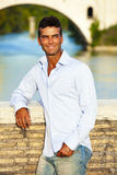 Handsome man Italian outdoors in Rome Italy. Tiber river and bridge Royalty Free Stock Photos