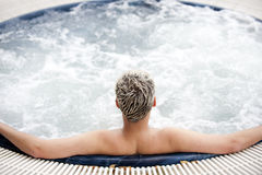 Handsome man in jacuzzi Royalty Free Stock Photo