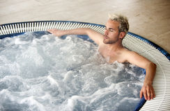 Handsome man in jacuzzi Stock Photos